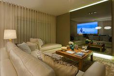 Sala Comum_televisão ligada: Salas de estar modernas por Traço Magenta - Design de Interiores
