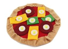 Kids love playing with pretend felt food, and the Button Felt Food adds some fine motor skill to the fun. The Pizza button food starts with a pizza crust, and t