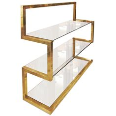 A brass shelve by Milo Baughman | From a unique collection of antique and modern shelves at https://www.1stdibs.com/furniture/storage-case-pieces/shelves/