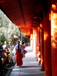 miko (shrine maiden)at Kasuga Grand Shrine, Nara, Japan