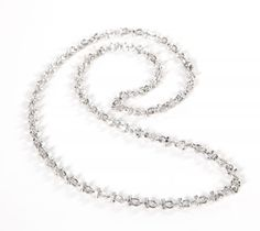 A white metal chain worn by Denzel Washington in Training Day. The spur link chain, has a swivel hook closure.