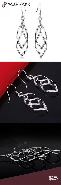 Nice Silver Interlocking Leaf Spiral Earrings Specifications:  4.0 x 1.5cm  Product Weight:   3.6g   Material: .925 Stamped sterling silver ( I can not find it on the earring) Anti-tarnish finish Jewelry Earrings