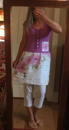 Repurposed upcycled recycled tunic top/dress featuring a purple old navy knit t-shirt with ruffled front placket w/ buttons...finished off with a coordinated white linen skirt with large pink flowers. Very cute as a flirty dress or as shown on me...as a tunic with skinny pants or