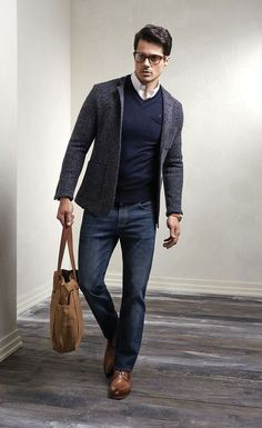 Brown Leather Tote Bag styled with Charcoal Wool Blazer, Navy V-neck Sweater, White Sleeve Shirt, Navy Jeans and a pair of Brown Derby Shoes