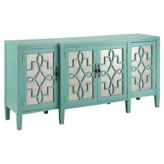 Showcasing mirrored door fronts and 4 doors, this lovely credenza is perfect for stowing spare table linens or dinnerware in your dining room or kitchen.
