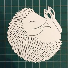 Took a break from cutting hot air balloons to re cut this guy - logo hedgehog ☺️about 6 times the size of the original just so I could get his spikes more...spikey! Next mission is to work out how to use my scanner so I can scan him in and make use of him #technophobe #ijustwanttocutprettythingsoutofpaper #notimeforthiscomputerfaff #hedgehog #logo #paper #pretty #paperart #papercut #paperartist #papercutter #papercutting #handdrawn #handcut #handmade #illustration #childrensillustration…