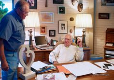 In his office, James Avery discusses the 3-dimensional wooden model of the sculpture with craftsman Marlin Schumann.