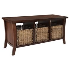 An essential addition to your entryway or mudroom, this charming wood bench showcases a curved design and 3 wicker storage baskets.