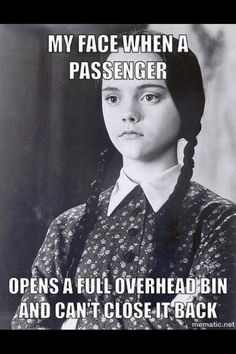 The look when a passenger opens a full bin and can't get it closed again.