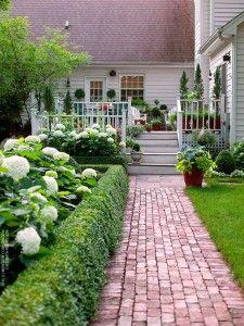 Brick path leading to backyard patio