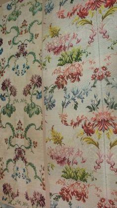 Beaux lampas « pour la robe », Lyon, époque Louis XV vers 1750-60. Compositions en miroir de guirlandes d'oeillets et fraises pour l'un ; de fleurs multicolores lattées pour l'autre (chasubles démontées). - On joint un métrage de satin lancé rose et vert anis d'une robe démontée (usures).