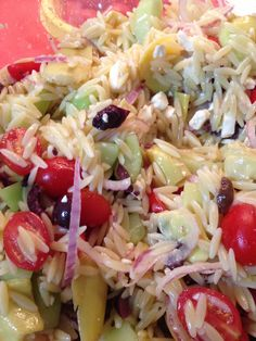 Orzo pasta, black olives, artichoke hearts with marinade, grape tomatoes, olive oil, salt, black pepper, thinly sliced red onion and Parmesan cheese grated on top. Optional- diced pepperoni or Tasso