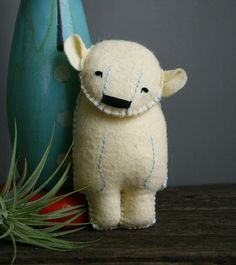 felt polar bear (would be cute with plaid scarf and used as a Christmas ornament)