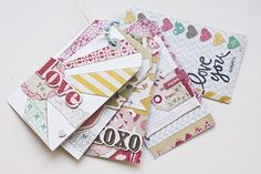 Make a mini scrapbook held together with a ring on the top.  Great step by step tutorial!