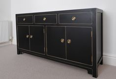Black sideboard with gold fittings.  www.instagram.com/hallwoodfurniture