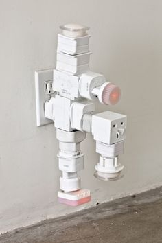 """Philippe Parreno/ """"AC/DC"""" Snake/ 2010/ electric outlet adapters"""