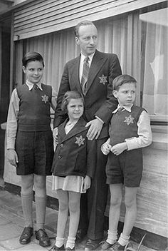 Belgian Jewish children with their father wearing the Star of David
