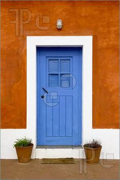 Beautiful And Funny Orange House With Blue Doors