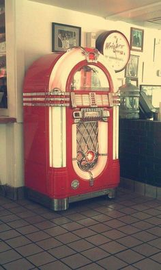 [a giant vintage red jukebox. an absolute unit.]