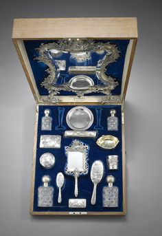 A silver dressing set, Fabergé and other marks height of mirror: 60 cm. (23 ½ in.)-bonhams.com/auctions/14214/lot/212