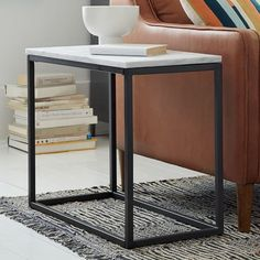 "Box Frame Narrow Side Table - Marble | west elm, marble top, antique bronze-finished steel frame, 28""w x 14""d x 22.75""h, $349"