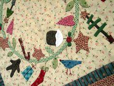 http://hatchedandpatched.typepad.com/.a/6a00e008c5cdce883401676894b39f970b-pi.parte de apliques de una corona en un quilt.