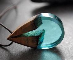Super cool!! a fusion of driftwood and blue colored resin. Pendant 42x22x10mm