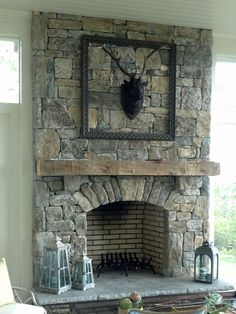 Living Room, : Natural Stone Fireplace Idea With Old Wooden Shelves And Deer Hooks And Metal Trim Decoration