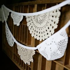 doily bunting, what a great use for all those lost doilies in the bins at the thrift.  would be great to pull out for the baby showers and birthdays and anniversaries too