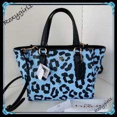 """2X Host PickCOACH CROSBY CARRYALL #34334~RARE COACH CROSBY CARRYALL #34334 ~ RARE!Not a Factory Bag & Hard to find in this Color! Retail: $350 The Crosby gets an unexpected update in pastel with a playful ocelot print. Structured and surprisingly spacious, the compact design comes finished with bound leather edges and a detachable strap for shoulder or crossbody wear. Handles with 5"""" drop Crossgrain Leather with Zip-top closure Includes Dust Bag & Gift Box 12.5"""" (L) x 7.25"""" (H) x 5.5"""" (W)…"""
