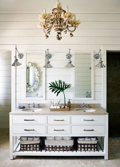 A shell chandelier looks apropos in this otherwise subtle bath. | Alessandra Brance