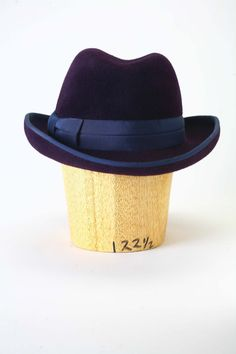 Distinguished and cool mens homburg with wider brim. The crown has a dent running down the middle and the brim is shaped in kettle curl style