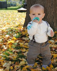 Who is loving this Fall weather? 🍁🍂This little stud sure is especially the crisp air, crunchy leaves and who can forget his pacifier!   #pacifierclip #fall #instacutie