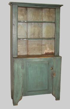 """PAINTED OPEN TOP CUPBOARD. One-piece stepback cupboard in distressed blue paint. Shaped shelves and cutout feet. Loose backboard. 74""""h. 36""""w. 14 1/2""""d."""