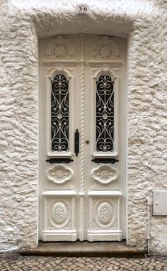Rosamaria G Frangini | Architecture Doors | Portimão, Faro, Portugal, white entrance, carved wooden door, doorway, lovely, gorgeous, beauty