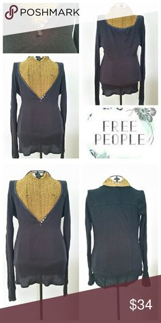 """FREE PEOPLE navy plunge waffle knit thermal henley Comfy sexy thermal Sz L Navy Plunge v neck with 3 tiny buttons Waffle knit...cotton...very stretchy Underarm to underarm 18"""" unstretched  Underarm to sleeve end 23.5"""" Top of shoulder to hem 27"""" Very good preloved condition Free People Tops Tees - Long Sleeve"""