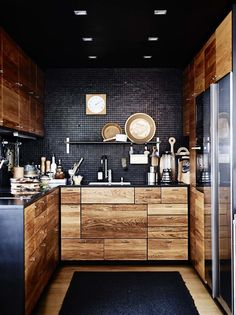 black kitchen - modern yet homey. I DO NOT like minimalist, but you don't have to have minimalism to have modern