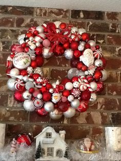 Used mostly red & white glass ornaments for this Christmas wreath...hangs above our fireplace.