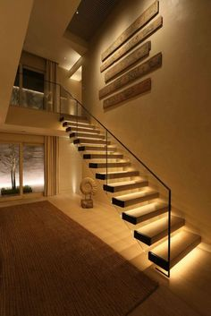 Today's emphasis? The stairs! Here are 26 inspiring ideas for decorating your stairs tag: Painted Staircase Ideas, Light for Stairways, interior stairway lighting ideas, staircase wall lighting. Staircase Lighting Ideas, Stairway Lighting, Floating Staircase, Wall Lighting, Lights On Stairs, Pendant Lighting, Corridor Ideas, Strip Lighting, Interior Lighting