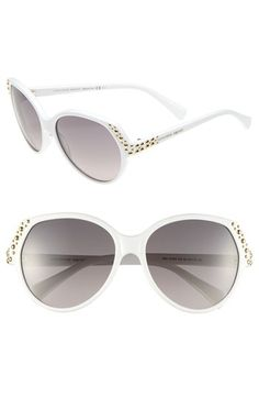 $450, Black and White Sunglasses: Alexander McQueen Studded Sunglasses White One Size. Sold by Nordstrom.