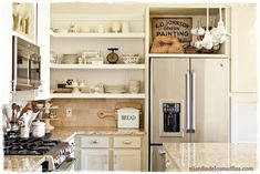Tour the stunning cottage of Little Cottage on the Pond that is filled with vintage charm. From flea market finds, painted furniture and fun collections. accessories shelves Eclectic Home Tour - Little Cottage on the Pond Kitchen Shelves, Kitchen Pantry, New Kitchen, Kitchen Decor, Kitchen Cabinets, Kitchen Ideas, White Cabinets, Fridge Decor, Upper Cabinets