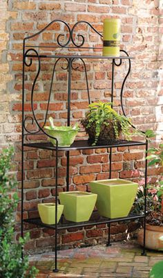 Outdoor bakers rack to herb pots on.