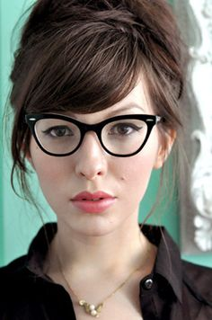 An Audrey Hepburn inspired hairstyle. I think this would suit the style of Rosetta. Wearing glasses?