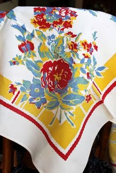 A lovely vintage tablecloth. I own one much like this and use it often.