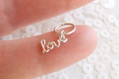 FREE SHIPPING USA: Spend $50 or more, use code SHIP4FREE. FREE SHIPPING FOR INTERNATIONAL ORDERS: Spend $75 or more, use code Spend $50 or more, use code FREEINTL     This listing is for a custom word CHARM - it will have ONE small jump ring to attach to a necklace or charm bracelet or anything of your choice.    Choose solid sterling silver or yellow gold filled    Let me know word or name at checkout in message to seller    **This listing is NOT an earring and will NOT have the large…