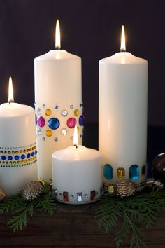 Inexpensive craft store gems are a fun way to liven up plain white candles. www.HolidaywithMatthewMead.com