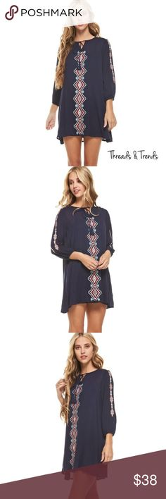 Navy Embroidered Slip Dress 3/4 sleeve loose fit mini dress with embroidered design detail and fringe drawstring. Fully lined. 100% Rayon Hand wash cold do not bleach, hang dry. Threads & Trends Dresses