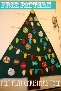 Felt Play Christmas Tree with magnets to attach to the back of the front door.  Free printable pattern for the ornaments.