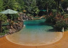 This tropical beach-entry pool has the look and feel of a private beach resort! How can you get a pool like this in your own backyard? Learn more in our Top 6 Pool Design Features >> http://www.poolspaoutdoor.com/blog/entryid/140/top-6-swimming-pool-design-features-infinity-pool-beach-entry-lap-pool.aspx    Photographed by Rick Legnon for Advanced Pools, Rancho Cordova, CA