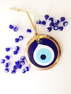 A personal favourite from my Etsy shop https://www.etsy.com/listing/278476134/gold-evil-eye-bead-7cm-evil-eye-wall